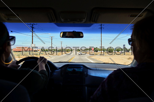 two ladies driving on the road