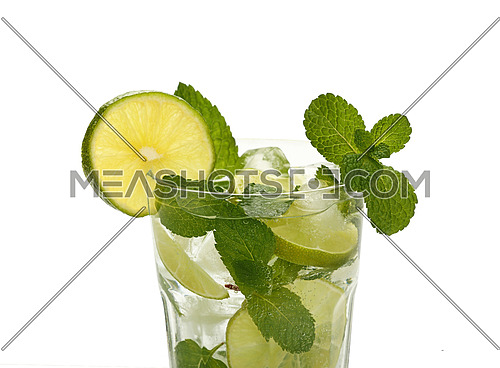 Close up one full, big glass of mojito with mint leaves, lime slices and ice cubes, isolated on white background, high angle side view