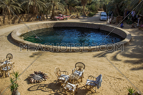 Long shot for Cleopatra eye of Siwa Oasis at day