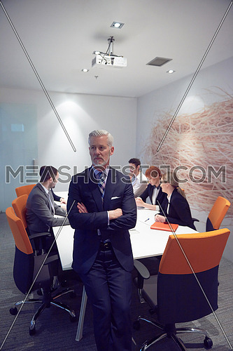 senior businessman with his team at modern office. business people group