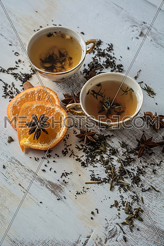 Tea, orange and anise on wooden background