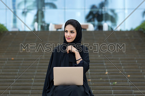 Arabic lady working and thinking
