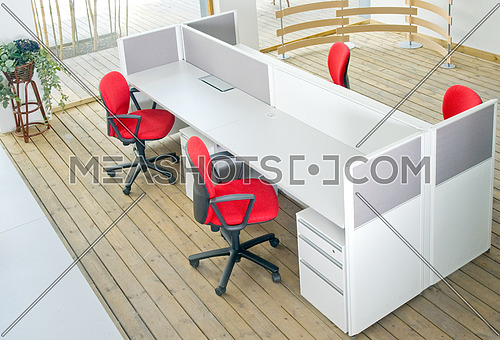office desks and red chairs cubicle set view from top over wood flooring