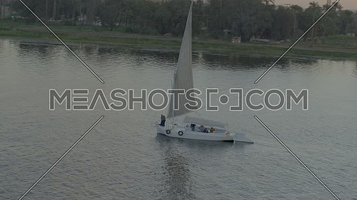 Fly over the River Nile showing a Sailboat at sunset - December 2018.