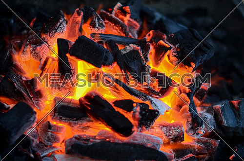 Fire flamed into coal on a metal grill