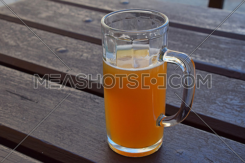 One glass of unfiltered craft draft wheat weizen beer on wooden table