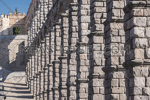 Partial view of the Roman aqueduct and wall located in the city of Segovia, Unesco World Heritage Site, Spain