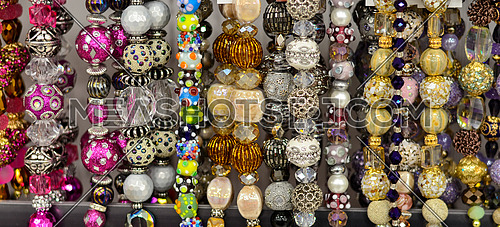 colorful  jewelry stones hanged in a shop