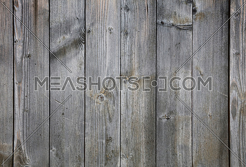 Old vintage aged grunge uneven gray faded wooden vertical planks texture background with stains