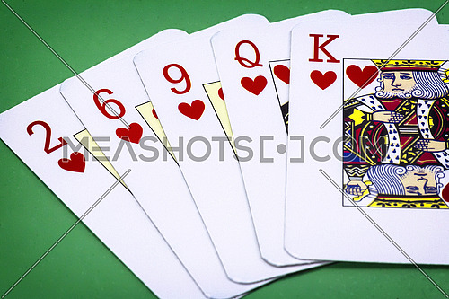cards poker deck English, Poker hand call color, consisting of five letters of hearts, two of hearts, six of hearts, nine of hearts lady and king of hearts on green background
