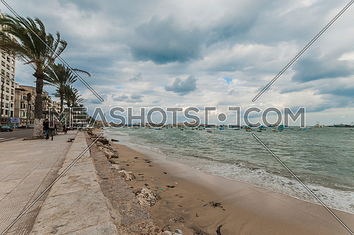 Shot for sea shore showing fishing boats and street at alexandria at day