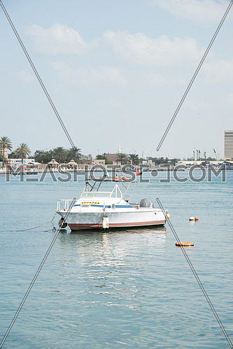 a small boat parked in the dubai creek