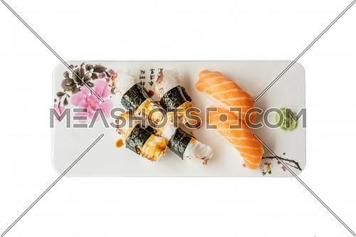 Sushi plate on white background, view from above.