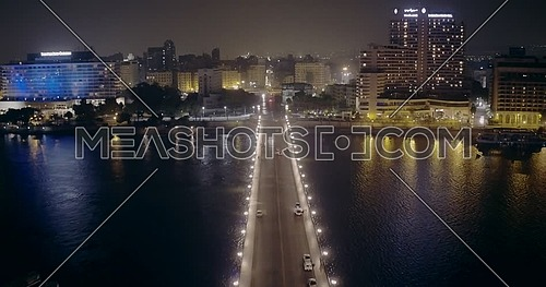 Drone shot fly towards Opera Square untill Kasr Al Nile Bridge in Cairo at night