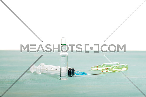 Medical vials and syringe isolated on white background, vaccination concept and disease treatments