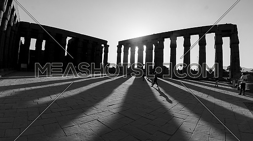 Sunset in the city of Luxor on Luxor Temple in black and white