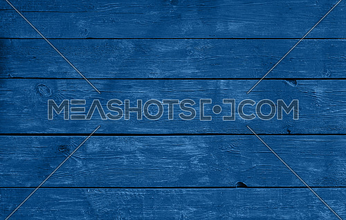 Close up background texture of dark blue vintage weathered painted wooden planks, classic rustic style wall panel
