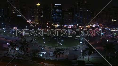 Fly Over for Al Mohandseen area revealing Moustafa Mahmoud Square 22th of March 2018 in Giza  at Night