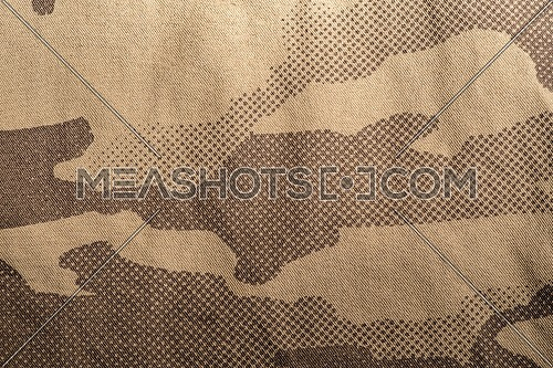 Textile camouflage cloth texture. Closeup of military uniform surface.
