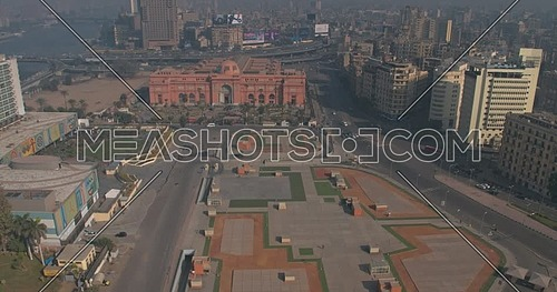 Drone Shot for Tahrir area in Downtown in Cairo at daytime showing Egyptian Museum, October Bridge, Opera Parking