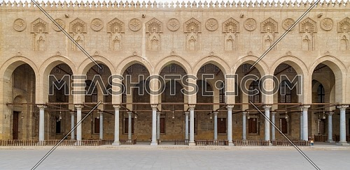 Arched corridor surrounding the courtyard of public ancient mosque of Sultan Al Moaayad, Old Cairo, Egypt