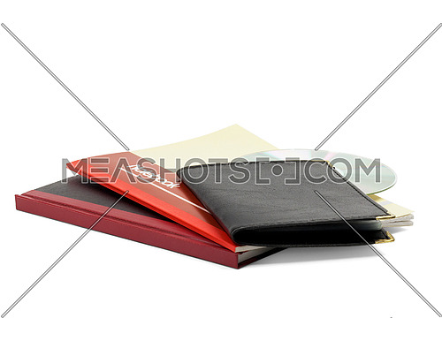 assorted notebooks and cd isolated on white background