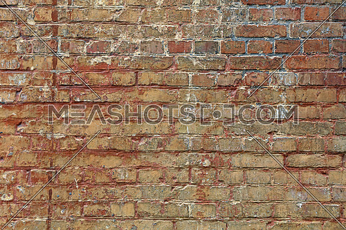 Old weathered aged rough brown brick wall background texture with white and red paint stains and runs, close up, side view