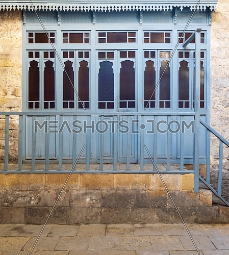 Changing rooms with blue wooden door shutters and wooden balustrades at historical traditional Turkish public bathhouse (Hamam Inal), Moez Street, Cairo, Egypt