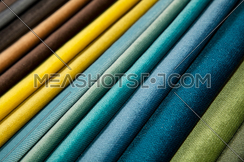 Colorful multicolored fabric samples swatch in textile catalogue palette, selection of different colors and textures range to choose for interior design and furniture decoration