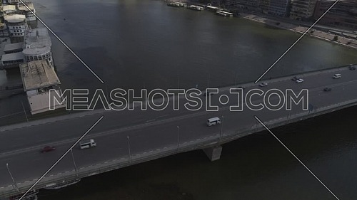 Aerial shot flying over Cairo Downtown empty streets showing 6th of Octobre bridge and the River Nile during the corona pandemic lockdown by day 10 April 2020