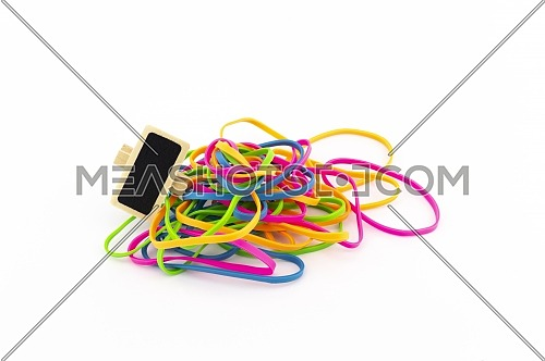 Pile of colorful rubber bands and small slate or signboard isolated on white background
