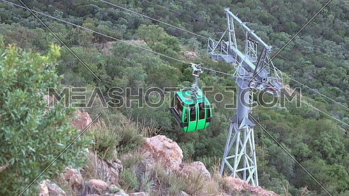 Scene of a car moving up the aerial cableway Hartbeespoort