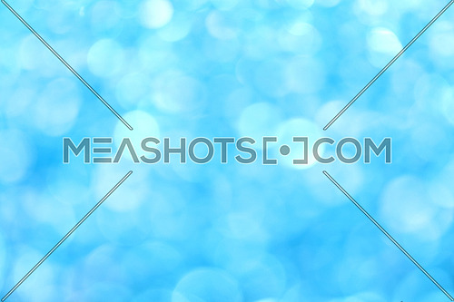Winter day blue glitter bright magic fairy light snow circles Christmas abstract blur effect background