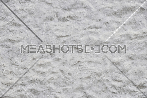Rough white wall surface of decorative embossed painted lime plaster texture background