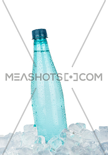 One full PET plastic bottle of cold still drinking water chilling on ice cubes isolated on white background, low angle side view