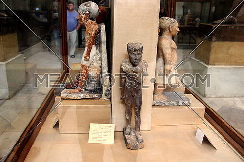 a photo from inside the Egyptian museum showing a display of monumental statues belonging to ancient pharaohs civilization