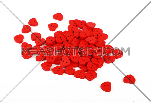 Red heart shaped handmade wooden sewing buttons isolated on white, close up, high angle view