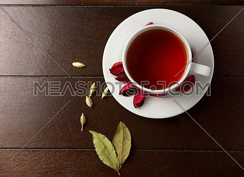Morning Tea in a white cup on a wooden table top