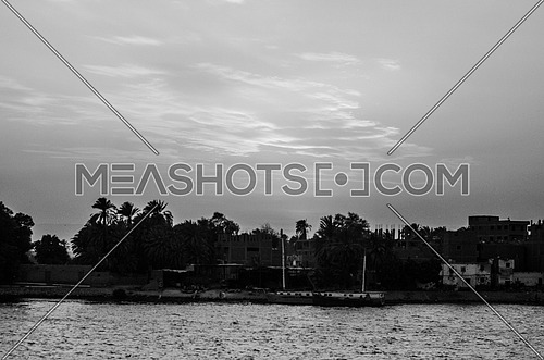 A silhouette of the Nile river during sunset black and white.