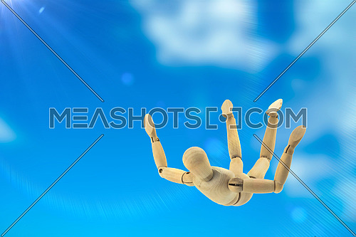 Doll wood flying in the sky in free fall, conceptual image