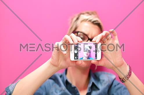 woman taking selfie in startup office
