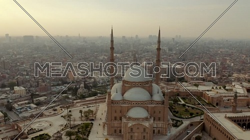 Flying through Mosque of Mohamed ali in Cairo citadel revealing Old Cairo