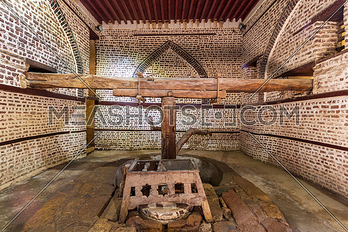 Wooden painted floral patterns, embedded arched niche, wooden door, wooden engraved cupboard, calligraphy decoration, and marble floor with geometric pattern at El Sehemy ottoman era historic house