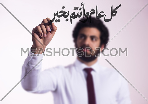 middle eastern business man draw with marker on virtual screen