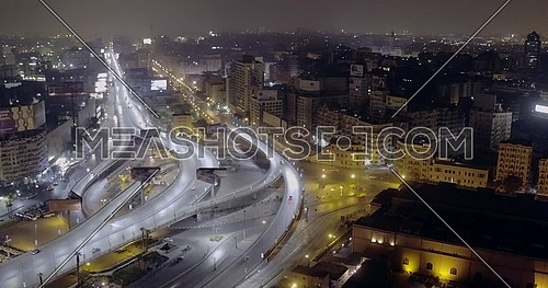 360 Drone shot for 6 of October Bridge over Abd Elmonan Reyad Bus Station At Tahrir Area in cairo at night