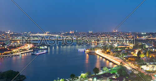 Istanbul city view from Pierre Loti Teleferik station overlooking Golden Horn with Halic Bridge, Golden Horn Metro Bridge and historical mosques, Eyup District, Istanbul, Turkey