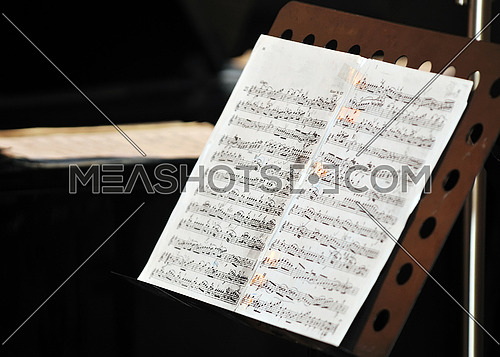 music book with letters at orchestra concert