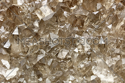 Cluster of clear transparent brown quartz mineral crystals (chemical composition SiO2) close up, high, angle, view,
