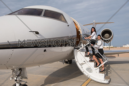 portrait of a young middle eastern businesswomen at the entrance to her private plane