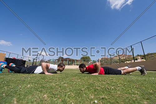 young middle eastern men athlete enjoys doing the extreme push-ups outside
